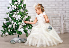 Pretty little girl  near the new year tree Royalty Free Stock Image