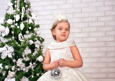 Pretty little girl  near the new year tree Royalty Free Stock Photos