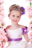Pretty little girl near pink flowers Stock Photo