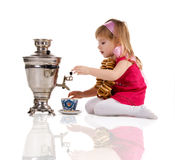 Pretty little girl near the samovar Stock Photo
