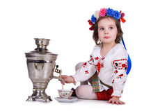 Pretty little girl near the samovar Royalty Free Stock Images
