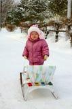 Pretty Little Girl Near Sled (sleigh). Stock Photo