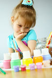 Pretty little girl painting Royalty Free Stock Images