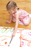 Pretty little girl painting Stock Photo