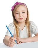 Pretty little girl paints on paper Royalty Free Stock Photos