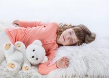 Pretty little girl in pajamas in bedtime stock image