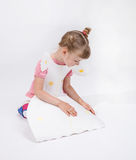 Pretty little girl in paper dress. On white background Stock Photography