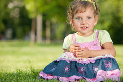 Pretty little girl in the park Royalty Free Stock Image