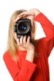 Pretty little girl with photo camera Stock Images