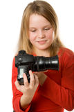 Pretty little girl with photo camera Stock Photography
