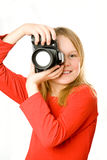 Pretty little girl with photo camera Royalty Free Stock Photo