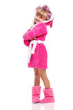 Pretty little girl in pink bathrobe with curlers Royalty Free Stock Photos