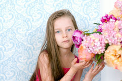 Pretty little girl in pink dress with flowers Royalty Free Stock Photos