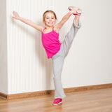 Little girl engaged in fitness Stock Photography