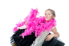 A pretty little girl with a pink feather boa Royalty Free Stock Image