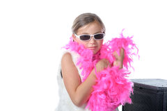 A pretty little girl with a pink feather boa Stock Images