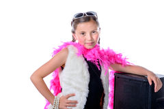 A pretty little girl with a pink feather boa Royalty Free Stock Photography