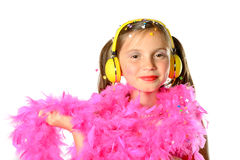 A pretty little girl with a pink feather boa Stock Image