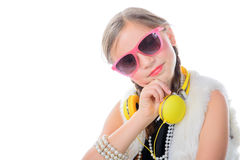 A pretty little girl with pink glasses and yellow headphones Royalty Free Stock Images