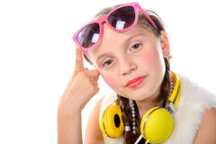 A pretty little girl with pink glasses and yellow headphones Stock Photography