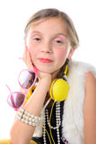 A pretty little girl with pink glasses and yellow headphones Stock Images