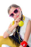 A pretty little girl with pink glasses and yellow headphones Stock Photo