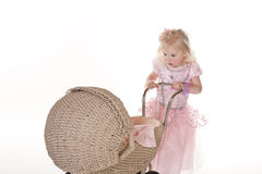 Pretty little girl in pink with stroller Royalty Free Stock Photo