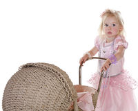 Pretty little girl in pink with stroller Stock Photos
