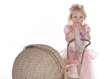 Pretty little girl in pink with stroller Stock Image