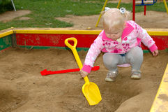 Pretty little girl play on playground in the park. Royalty Free Stock Image