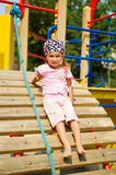 Pretty little girl on playground Stock Image