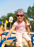 Pretty little girl on playground Royalty Free Stock Image