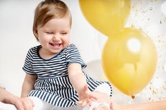 Pretty little girl playing with colorful balloons. Cute infant with group of balls Stock Photo
