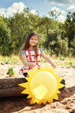 Pretty little girl playing with paper sun in park Royalty Free Stock Photos