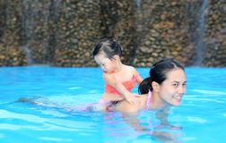 Pretty little girl playing in swimming pool outdoors royalty free stock photo