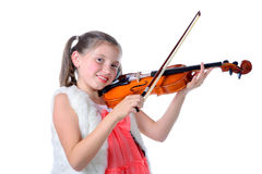 A pretty little girl playing the violin Royalty Free Stock Image