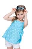 Pretty little girl in a polka dot blue dress Stock Photo