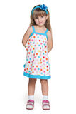 Pretty little girl in polka dot dress Stock Photos
