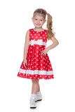 Pretty little girl in the polka dot dress Royalty Free Stock Photos