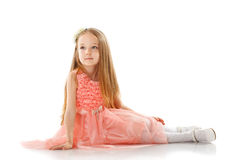 Pretty little girl posing in smart pink dress Stock Images