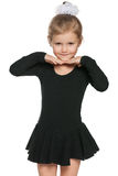 Pretty little girl prepares for dancing Royalty Free Stock Image