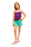 Pretty little girl in purple shirt Stock Images