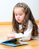 Pretty little girl reading a book Royalty Free Stock Photography