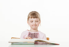Pretty little girl reading a book Stock Image