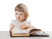 Pretty little girl reading an interesting book Stock Images