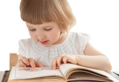 Pretty little girl reading an interesting book Royalty Free Stock Image