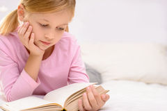 Pretty little girl reading royalty free stock image