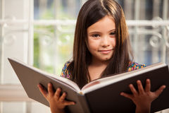 Pretty little girl reading a story Stock Photography