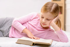 Pretty little girl reading Stock Photography
