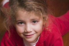 Pretty little girl in red Stock Images